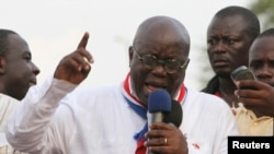 "FILE - New Patriotic Party presidential candidate Nana Akufo-Addo, shown protesting in Accra after the 2012 election of John Dramani Mahama, is ""campaigning hard"" to defeat him in the next election, NPP acting chairman Freddie Blay says."