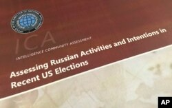 FILE - A part of the declassified version Intelligence Community Assessment on Russia's efforts to interfere with the U.S. political process is photographed in Washington, Jan. 6, 2017.