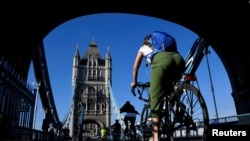 A cyclist is seen on Tower Bridge, following the outbreak of the coronavirus disease (COVID-19), London, Britain, May 15, 2020.