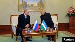 O'zbekiston rahbari Islom Karimov, Rossiya prezidenti Vladimir Putin Toshkentdagi uchrashuv paytida. 10-dekabr, 2014-yil.