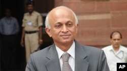 India's new Foreign Secretary, Ranjan Mathai, poses for media as he arrives at the External Affairs Ministry in New Delhi on August 1, 2011.
