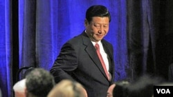 Wakil Presiden Tiongkok Xi Jinping saat memberikan pidato di depan US-China Business Council di Washington (15/2).