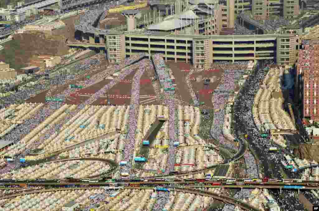 "In this image released by the Saudi Press Agency (SPA), hundreds of thousands of Muslim pilgrims make their way to cast stones at a pillar symbolizing the stoning of Satan in a ritual called ""Jamarat,"" the last rite of the annual hajj in Mina on the outskirts of the holy city of Mecca, Saudi Arabia."