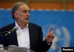 FILE - Jean Arnault, then the the U.N. secretary-general's special representative for Colombia, speaks in Funza, Colombia, Sept. 22, 2017.