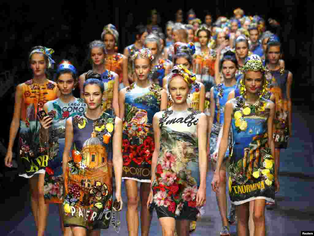 Models parade at the end of the Dolce & Gabbana Spring/Summer 2016 collection show during Milan Fashion Week in Italy.