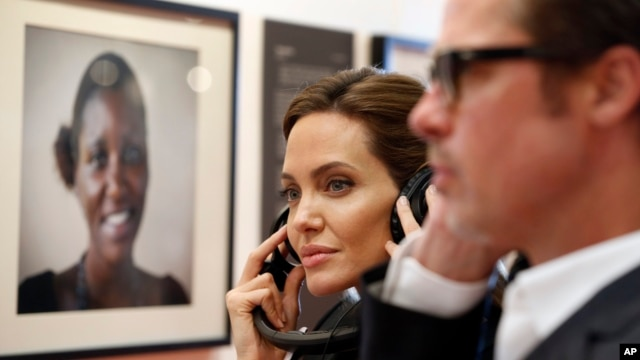 Angelina Jolie and Brad Pitt listen to victims' testimonies at a summit to end sexual violence in conflict, in London, June 12, 2014.