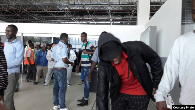 Somali nationals deported from the US arrive in Mogadishu. (Somali National News Agency -- SONNA)