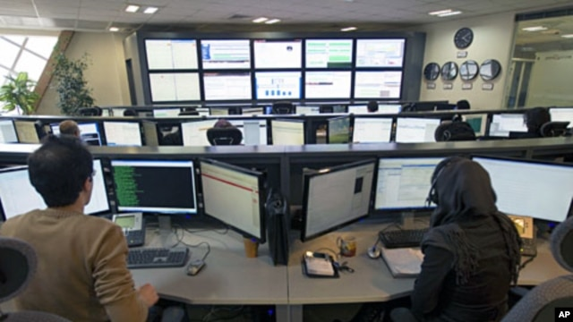 Iranian technicians monitor data flow in the control room of an internet service provider in Tehran, February 15, 2011