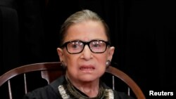 FILE - U.S. Supreme Court Associate Justice Ruth Bader Ginsburg is seen during a group portrait session for the new full court at the Supreme Court in Washington, Nov. 30, 2018.