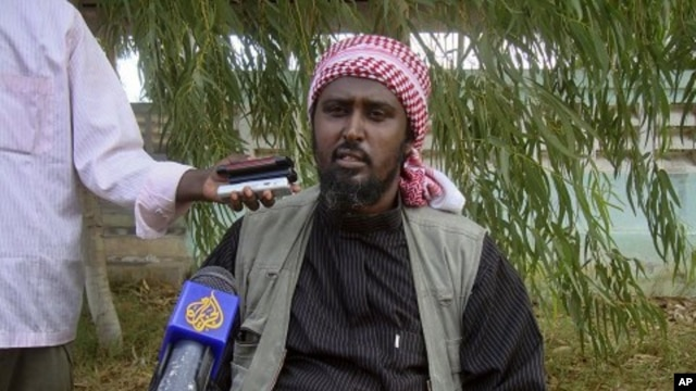 Al-Shabab spokesperson Ali Mohamud Rage holds a news conference in Mogadishu, Somalia, threatening Kenya,  October 17, 2011.