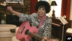 FILE - In this May 19, 2009, file photo, Wanda Jackson plays a pink guitar in her home in Oklahoma City.