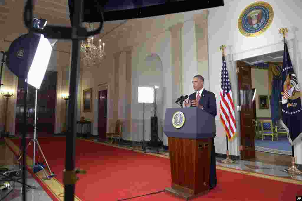 "President Barack Obama addresses the nation from the Cross Hall in the White House, ordering the United States into a broad military campaign to ""degrade and ultimately destroy"" Islamic State militants, in Washington, Sept. 10, 2014."