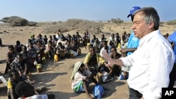 UN refugee agency chief Antonio Guterres (R) speaks to Ethiopian illegal immigrants from the Oromo region waiting for smugglers' boats to cross the Gulf of Aden into Yemen. Each year tens of thousands of Ethiopians and Somalis make the perilous crossing t