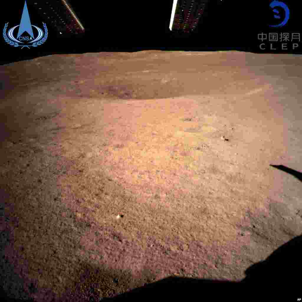 In this photo provided by China National Space Administration via Xinhua News Agency, the first image of the moon's far side taken by China's Chang'e-4 probe. A Chinese spacecraft made the first-ever landing on the far side of the moon, state media said.