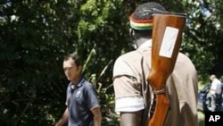 Armed men man the gates of a farm seized from white farmers in Chegutu 120km south west of Harare (File)