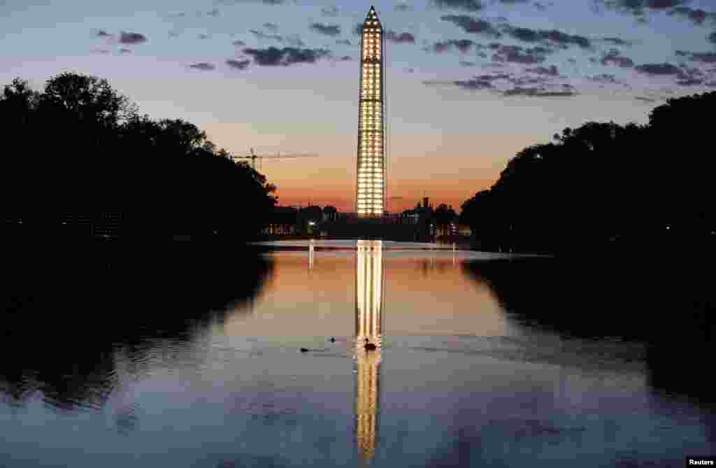The Washington Monument is reflected in a pool early in the morning before the start of the ceremony honoring the 50th anniversary of the 1963 March on Washington, D.C., USA.