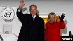 US Vice President Joe Biden (L) and his wife Jill wave upon their arrival at Boryspil International airport outside Kyiv November 20, 2014.