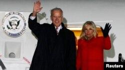US Vice President Joe Biden (L) and his wife Jill wave upon their arrival at Boryspil International airport outside Kyiv November 20, 2014.