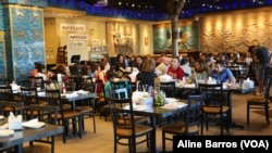 """The Ishtar Restaurant, its walls hung with reproductions of Assyrian deities, is a """"piece of home"""" for Iraqi nationals who come for the authentic Iraqi food and glass clinking presentations that proclaim """"tea time,"""" in Sterling Heights, Michigan, July 31, 2017."""