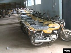 Motorcycles given to vigilantes are kept in Mora since the war has abated. (M.E. Kindzeka/VOA)