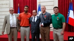 French President Francoise Hollande awarded the Legion of Honor medal on U.S. Airman Spencer Stone, National Guardsman Alek Skarlatos, and their years-long friend Anthony Sadler, who subdued the gunman as he moved through the train with an assault rifle strapped to his bare chest. The British businessman, Chris Norman, also jumped into the fray. (AP Photo/Michel Euler, Pool)