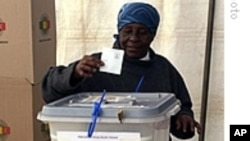 FILE: A woman casts her voter in the last general election.