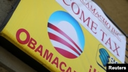 FILE - A sign on an insurance store advertises Obamacare in San Ysidro, San Diego, California, U.S.