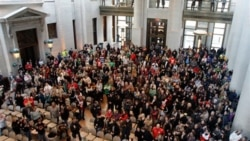 Protesters in the Ohio Statehouse on Wednesday after the state Senate passed a bill to cut the collective bargaining rights of public employees