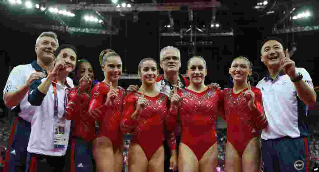 US gymnasts celebrate gold medal win with coaches after women's team final at 2012 Summer Olympics, July 31, 2012