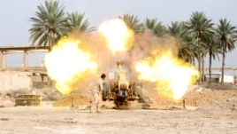 Iraqi security forces fire cannon during clashes with al Qaeda-linked Islamic State in Iraq and the Levant (ISIL), Jurf al-Sakhar, south of Baghdad, March 19, 2014.