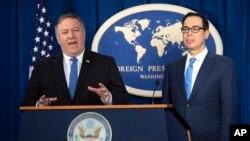 El secretario de Estado de EE.UU., Mike Pompeo, (izquierda) y el secretario del Tesoro, Steven Mnuchin, presentan los detalles de las nuevas sanciones a Irán en el Foreign Press Center en Washington el lunes, 5 de noviembre de 2018.