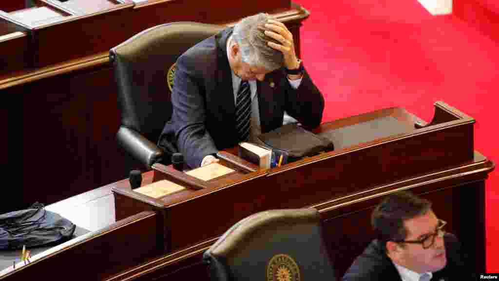 Republican State Senator Norman Sanderson holds his head while fellow Republican Senator Andrew Brock (R) looks during a failed attempt to repeal the controversial HB2 law limiting bathroom access for transgender people in Raleigh, North Carolina, USA, Dec. 21, 2016.