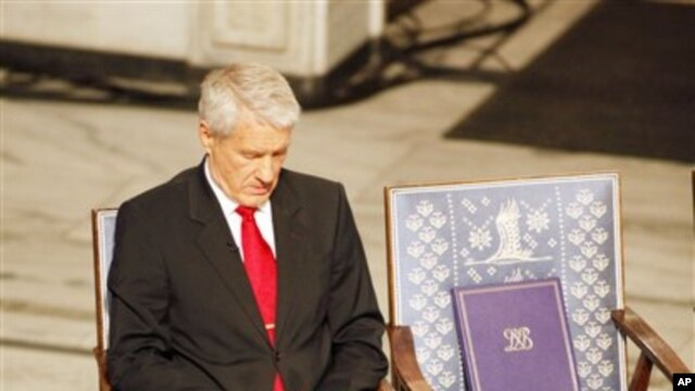 Nobel committee chairman Thorbjorn Jagland sits next to an empty chair with the Nobel medal and diploma for Nobel Peace Prize laureate Liu Xiaobo during a ceremony honoring Liu at city hall in Oslo, Norway Dec. 10, 2010.