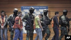 Soldiers escort Julian Zapata Espinosa, fourth right, alleged member of the Los Zetas drug cartel, and other suspects during a presentation for the media in Mexico City, February 23, 2011