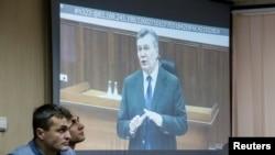 Виктор Янукович дает показания по видеосвязи (архивное фото)