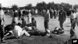Wounded people lie in the street in Sharpeville, near Vereeniging, where at least 180 black Africans, most of them women and children, were injured and 69 killed, when South African police opened fire on black protesters, 21 Mar 1960