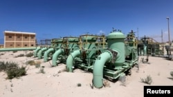 Pipelines are seen at the Zueitina oil terminal in Zueitina, west of Benghazi April 7, 2014.