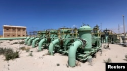FILE - Pipelines are seen at the Zueitina oil terminal in Zueitina, west of Benghazi, April 7, 2014.