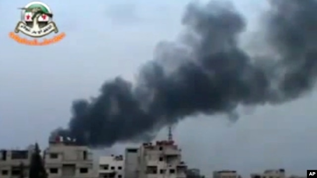 This image made from citizen journalist video posted by the Shaam News Network, which has been verified and is consistent with other AP reporting, shows smoke from shelling in the countryside of Damascus, Syria, Nov. 6, 2013.