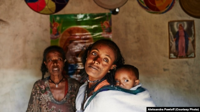FILE - Mebrit Kasua and one of her children at her home in the Tigray Province of northern Ethiopia. A new study says a newly launched national ambulance service has halved pregnancy-related births in the country.