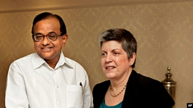Indian Home Minister P Chidambaram, left, shakes hands with US Secretary of Homeland Security Janet Napolitano, prior to a delegation level meeting in New Delhi, India, May 27, 2011.