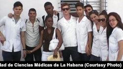 Juan Carlos Dominguez Lopez, second from left, and medical students at Universidad de Ciencias Médicas de La Habana.