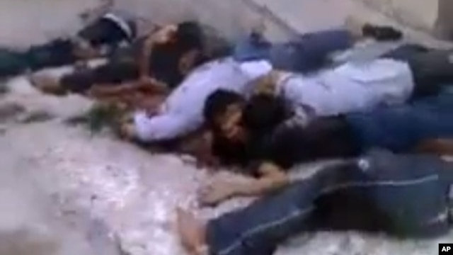 Human Rights Watch says these Syrians were killed execution-style in the village of al-Bayda May 3, 2013. Amateur video via AP.