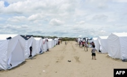 Hundreds of people from small villages close to the city of Piura, in northern Peru, are gathering in temporary camps, March 31, 2017, where they receive shelter, food and medical care.
