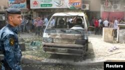 Hiện trường một vụ đánh bom ở quận Karrada, Baghdad, 30/5/2013