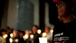 FILE - Activists and supporters of the Right2Know Campaign hold a night vigil outside the Constitutional Court in Johannesburg, Sept. 19, 2011.