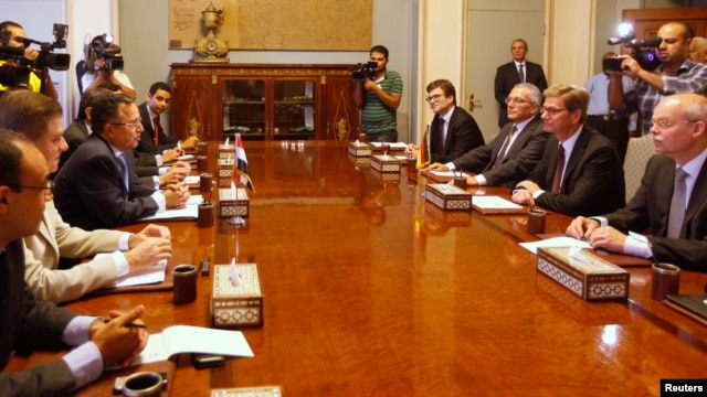 Egypt's interim Foreign Minister Nabil Fahmy (3rd L) speaks as German Foreign Minister Guido Westerwelle (2nd R) looks on during their meeting in Cairo, August 1, 2013.