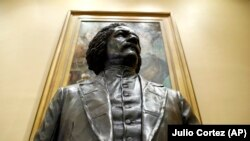 A bronze statue of abolitionist Frederick Douglass is seen during a private viewing ahead of its unveiling at the Maryland State House, Monday, February 10, 2020, in Annapolis.