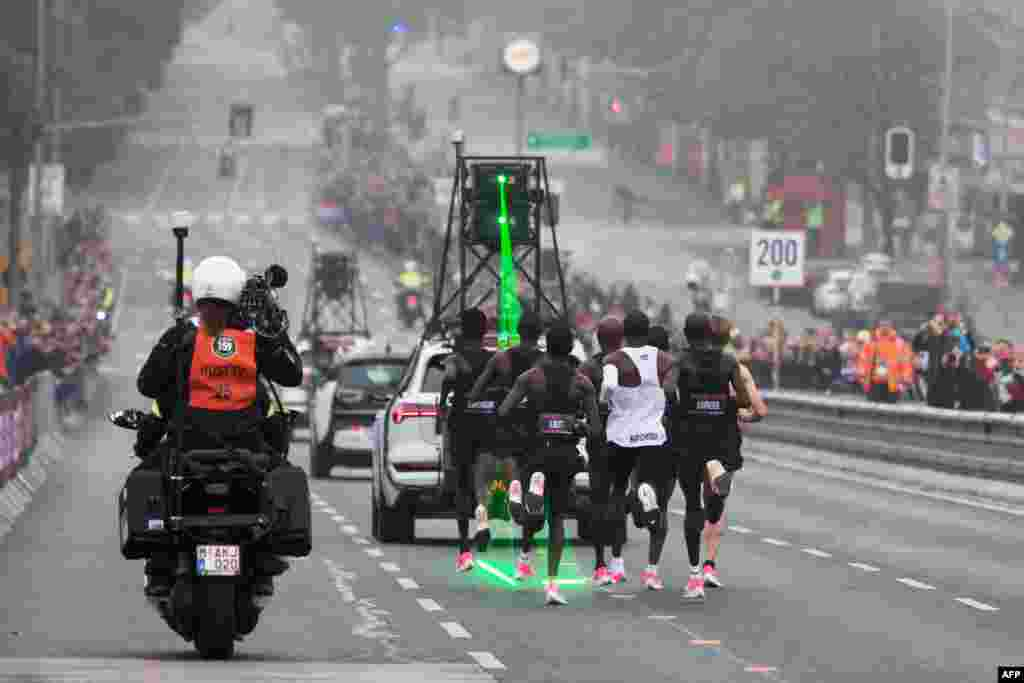 Kenya's Eliud Kipchoge (white jersey) takes the start of his attempt to bust the mythical two-hour barrier for the marathon in Vienna, Austria. Kipchoge held the men's world record for the distance with a time of 2hr 01min 39sec.