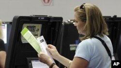 A voter checks her ballot during early voting in Miami, Florida